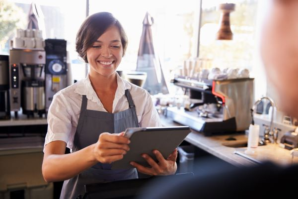 Woman Using Point of Sale in Cafe