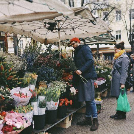 Market Flower Seller Preparing an Order