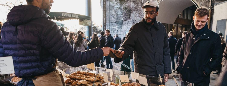 Group of Men Purchasing Food at Borough Market London