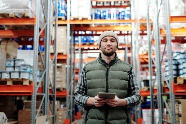 Man Using iPad in Warehouse