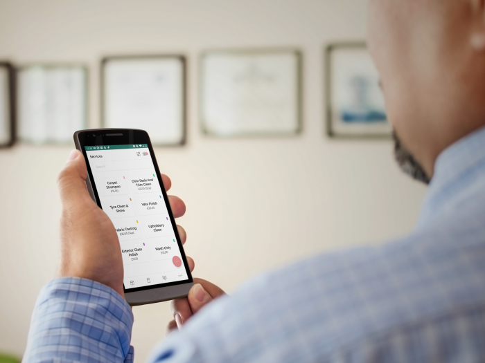 Man Viewing App on Mobile Device